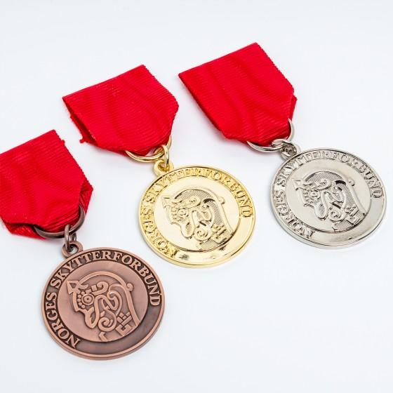 KM Medalje